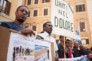 Act in memory of the victims of Lampedussa. Roma, Italia.